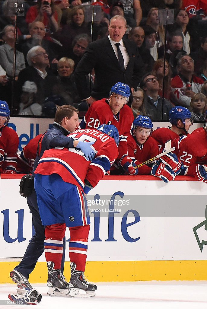 PierreAlexandre Parenteau of the Montreal Canadiens leaves the ice after being hit in the face against the Los Angeles Kings in the NHL game at the...