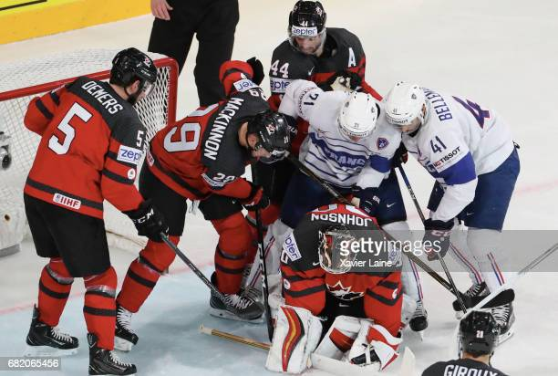 PierreEdouard Bellemare and Antoine Roussel of France play the puck over Chad Johnson of Canada during the 2017 IIHF Ice Hockey World Championship...