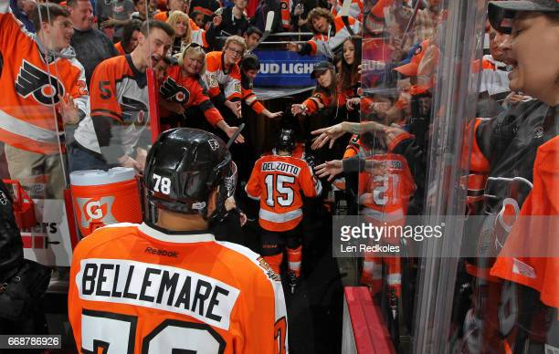 PierreEdouard Bellemare and Michael Del Zotto of the Philadelphia Flyers greet the fans while leaving the ice surface after a 43 shootout loss to the...