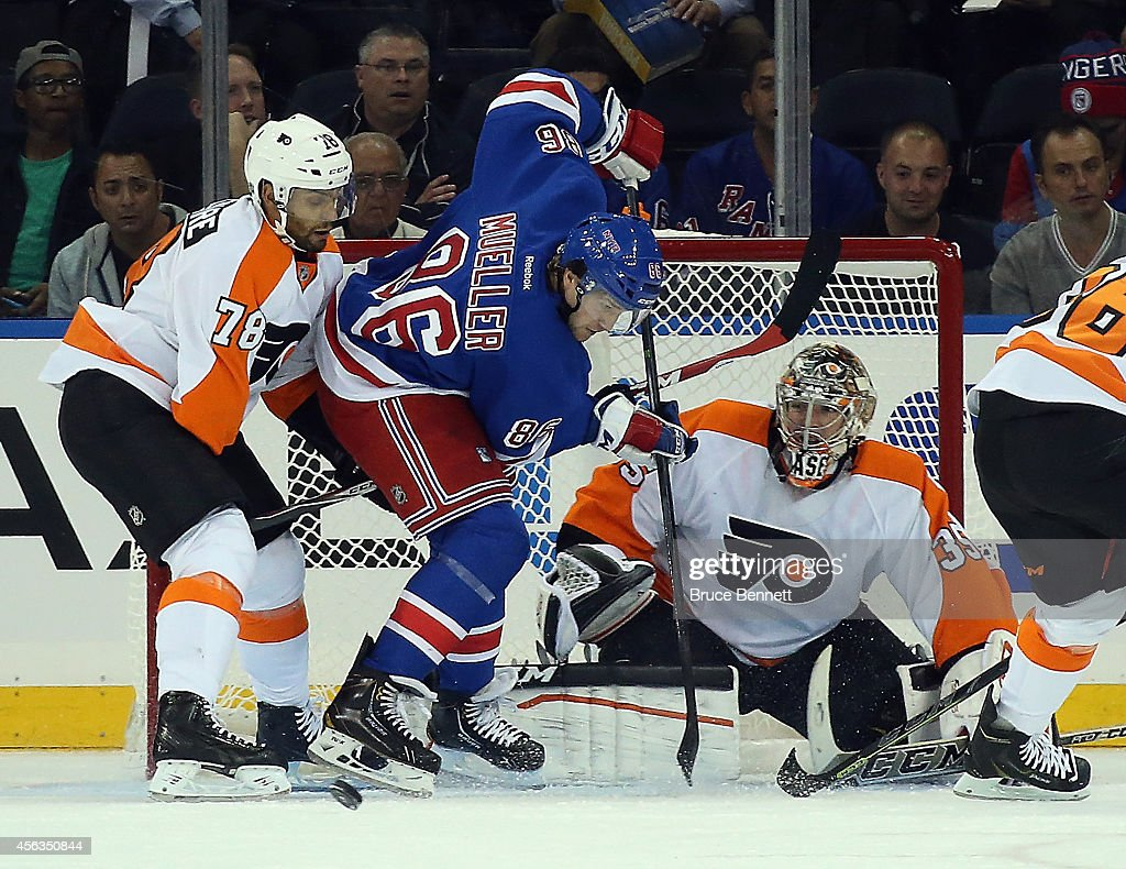 PierreEdouard Bellemare and Steve Mason of the Philadelphia Flyers defend against Chris Mueller of the New York Rangers during the first period at...