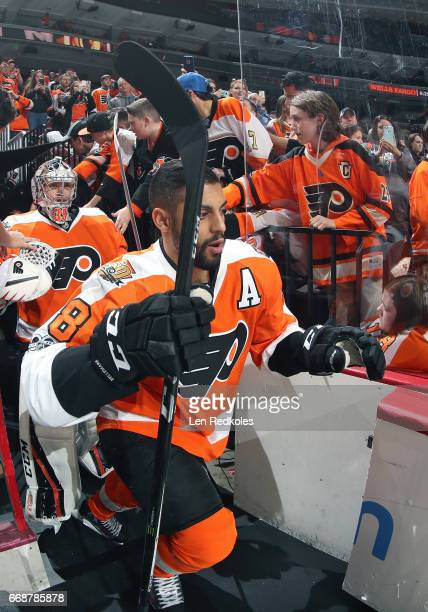 PierreEdouard Bellemare and Steve Mason of the Philadelphia Flyers enter the ice surface for warmups against the Carolina Hurricanes on April 9 2017...