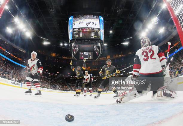PierreEdouard Bellemare and William Carrier of the Vegas Golden Knights celebrate the first home goal in franchise history by Tomas Nosek at 231 of...