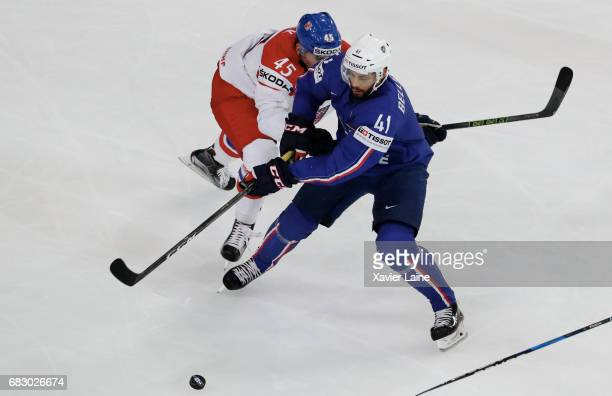 PierreEdouard Bellemare of France a in action with Radim Simek of Czech Republic during the 2017 IIHF Ice Hockey World Championship game between...