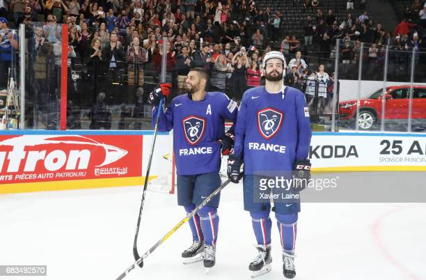 PierreEdouard Bellemare of France and Sacha Treille celebrate the end of career of Cristobal Huet and Laurent Meunier of France during the 2017 IIHF...