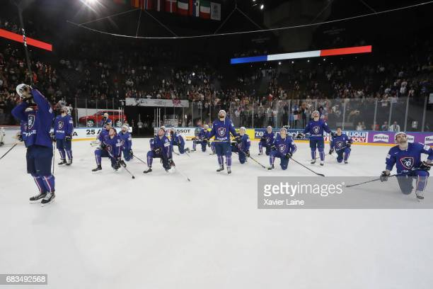 PierreEdouard Bellemare of France and teammattes celebrate the end of career of Cristobal Huet and Laurent Meunier of France during the 2017 IIHF Ice...