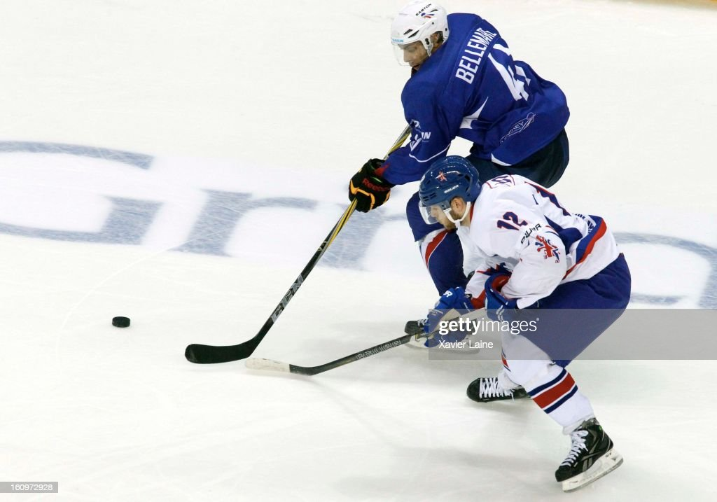 Pierre-Edouard Bellemare of France in action against Robert Dowd of Great Britain during the Sochi 2014 Olympic Ice Hockey Qualification match between France and Great Britain at Riga Arena on February 8, 2013 in Riga, Latvia.