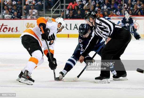 PierreEdouard Bellemare of the Philadelphia Flyers and Bryan Little of the Winnipeg Jets take a second period faceoff at the MTS Centre on March 21...