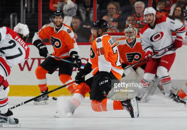 PierreEdouard Bellemare of the Philadelphia Flyers attempts to block a shot by Justin Faulk of the Carolina Hurricanes on March 19 2017 at the Wells...