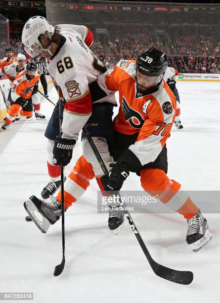PierreEdouard Bellemare of the Philadelphia Flyers battles for the loose puck with Jaromir Jagr of the Florida Panthers on March 2 2017 at the Wells...