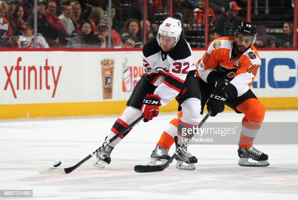 PierreEdouard Bellemare of the Philadelphia Flyers battles for the puck against Michael Kapla of the New Jersey Devils on April 1 2017 at the Wells...