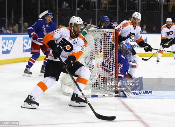 PierreEdouard Bellemare of the Philadelphia Flyers brings the puck around the front of the crease against Henrik Lundqvist of the New York Rangers at...