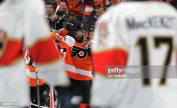 PierreEdouard Bellemare of the Philadelphia Flyers celebrates with teammates after defeating the Florida Panthers 21 in a shootout on March 2 2017 at...