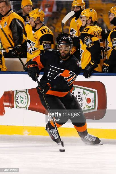 PierreEdouard Bellemare of the Philadelphia Flyers controls the puck during the game against the Pittsburgh Penguins at Heinz Field on February 25...