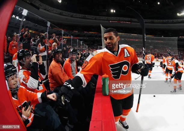 PierreEdouard Bellemare of the Philadelphia Flyers fist bumps a fan on March 19 2017 at the Wells Fargo Center in Philadelphia Pennsylvania