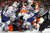 PierreEdouard Bellemare of the Philadelphia Flyers lays at the bottom of a scrum between teammates and Toronto Maple Leafs players during the second...