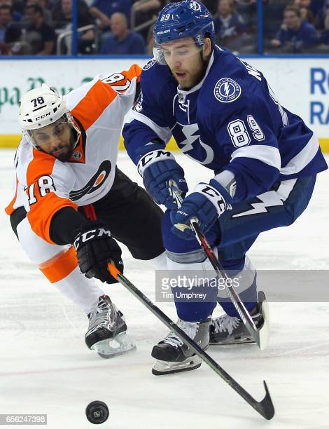 PierreEdouard Bellemare of the Philadelphia Flyers plays in the game against Nikita Nesterov of the Tampa Bay Lightning at Amalie Arena on March 11...