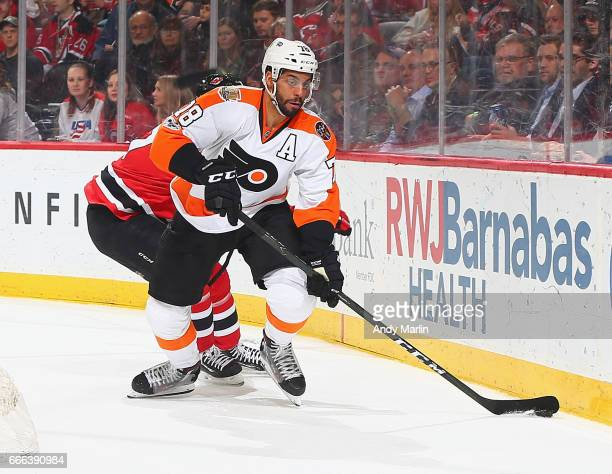 PierreEdouard Bellemare of the Philadelphia Flyers plays the puck against the New Jersey Devils during the game at Prudential Center on April 4 2017...