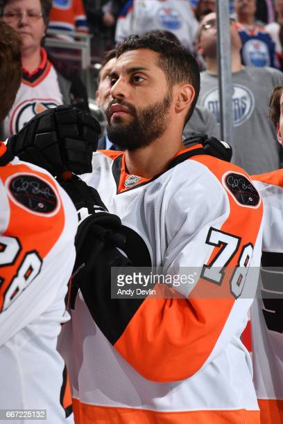 PierreEdouard Bellemare of the Philadelphia Flyers stands for the singing of the national anthem prior to the game against the Edmonton Oilers on...