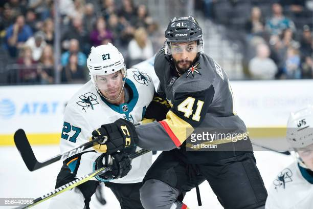 PierreEdouard Bellemare of the Vegas Golden Knights and Joonas Donskoi of the San Jose Sharks battle for position during the game at TMobile Arena on...