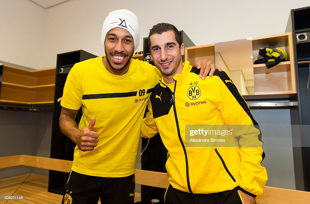 Pierre-Emerick Aubameyang and Henrikh Mkhitaryan of Borussia Dortmund celebrate the win together in the changing room after the DFB Cup match between VfB Stuttgart and Borussia Dortmund at Mercedes-Benz Arena on February 09, 2016 in Stuttgart, Germany.