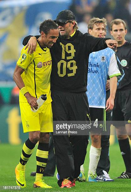 PierreEmerick Aubameyang and Juergen Klopp head coach of Dortmund celebrate the victory after the DFB Cup match between TSV 1860 Muenchen and...