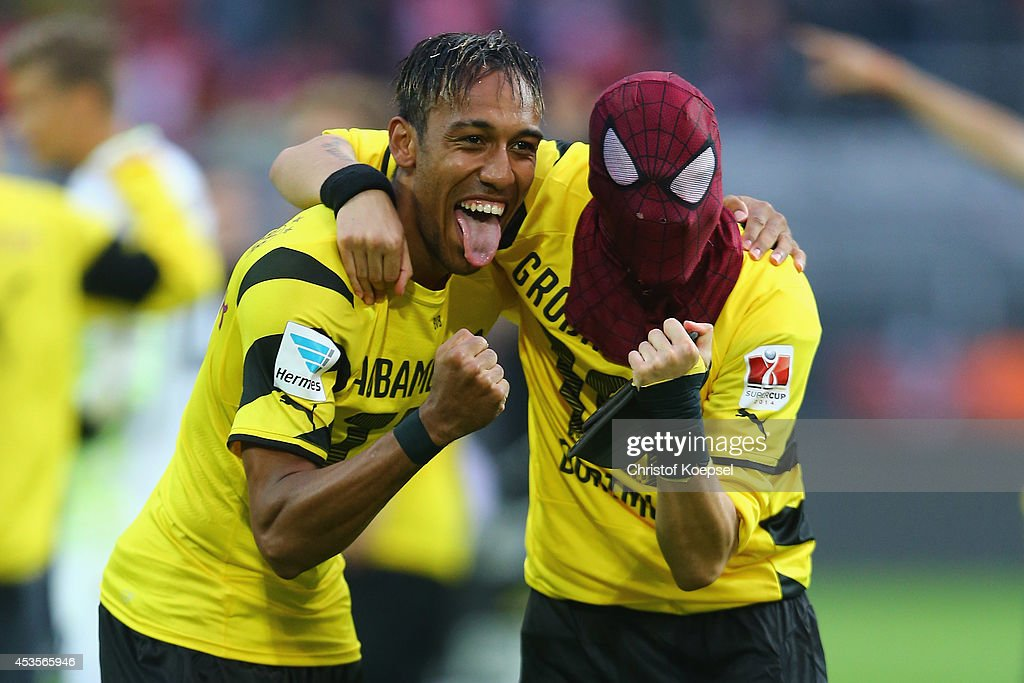 <a gi-track='captionPersonalityLinkClicked' href=/galleries/search?phrase=Pierre-Emerick+Aubameyang&family=editorial&specificpeople=6344916 ng-click='$event.stopPropagation()'>Pierre-Emerick Aubameyang</a> and <a gi-track='captionPersonalityLinkClicked' href=/galleries/search?phrase=Kevin+Grosskreutz&family=editorial&specificpeople=4265546 ng-click='$event.stopPropagation()'>Kevin Grosskreutz</a> of Dortmund celebrate winning 2-0 the DFL Supercup match between Borussia Dortmund and FC Bayern Muenchen at Signal Iduna Park on August 13, 2014 in Dortmund, Germany.