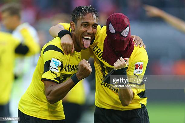 PierreEmerick Aubameyang and Kevin Grosskreutz of Dortmund celebrate winning 20 the DFL Supercup match between Borussia Dortmund and FC Bayern...