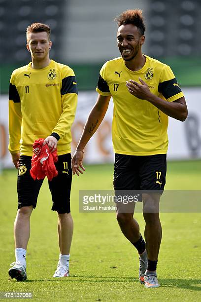 PierreEmerick Aubameyang and Marco Reus of Borussia Dortmund look on during the DFB Cup Final 2015 training session at Olympiastadion on May 29 2015...