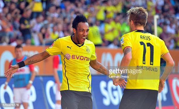 PierreEmerick Aubameyang and Marco Reus of Dortmund celebrate their second goal during the Bundesliga match between FC Augsburg and Borussia Dortmund...