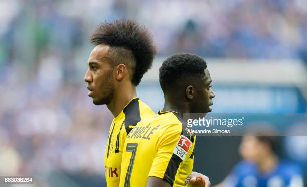 PierreEmerick Aubameyang and Ousmane Dembele of Borussia Dortmund in action during the to the Bundesliga match between FC Schalke 04 and Borussia...