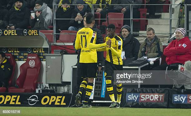 PierreEmerick Aubameyang and Ousmane Dembele of Borussia Dortmund during the Bundesliga match between 1 FSV Mainz 05 and Borussia Dortmund at the...