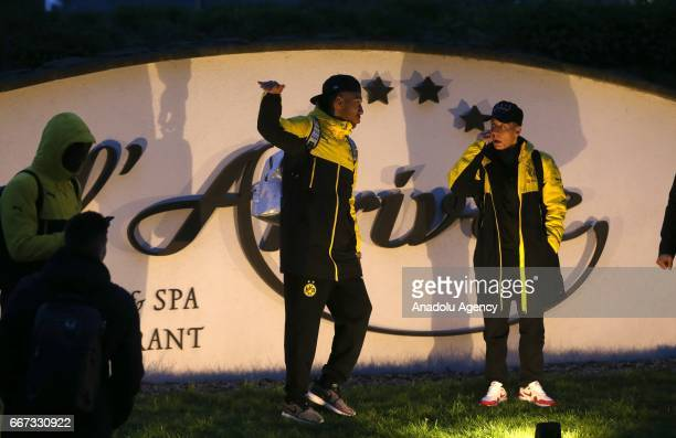 PierreEmerick Aubameyang and Ousmane Dembele of Borussia Dortmund stand after explosions at the hotel L'Arrivee in Germany on April 11 2017 The UEFA...