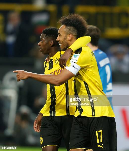 PierreEmerick Aubameyang and Ousmane Dembele of Dortmund celebrate the 30 against Hamburg during the Bundesliga soccer match between Borussia...