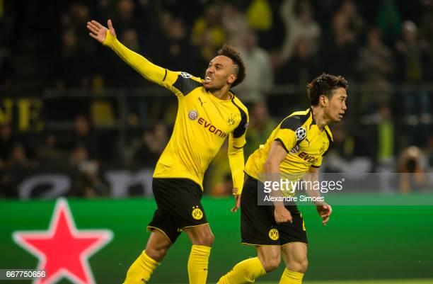 PierreEmerick Aubameyang and Shinji Kagawa of Borussia Dortmund celebrate the goal to the 12 from Ousmane Dembele during the UEFA Champions League...