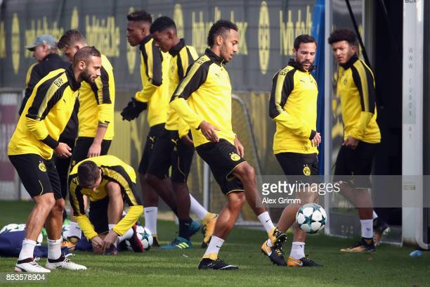 PierreEmerick Aubameyang and team mates attend a Borussia Dortmund training session ahead of their UEFA Champions League Group H match against Real...