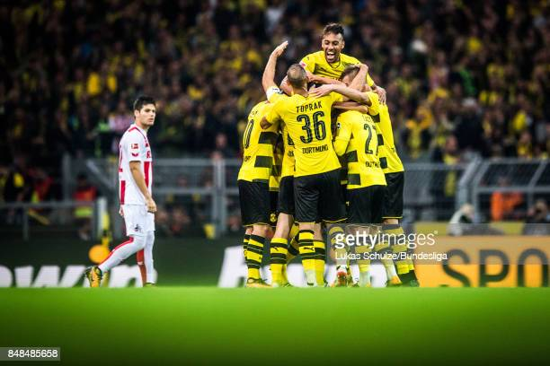 PierreEmerick Aubameyang and team mates of Dortmund celebrate a goal during the Bundesliga match between Borussia Dortmund and 1 FC Koeln at Signal...