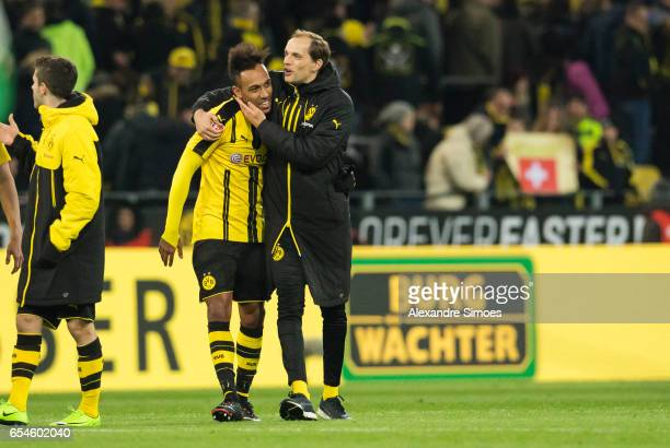 PierreEmerick Aubameyang and Thomas Tuchel of Borussia Dortmund celebrate the win after the final whistle during the Bundesliga match between...