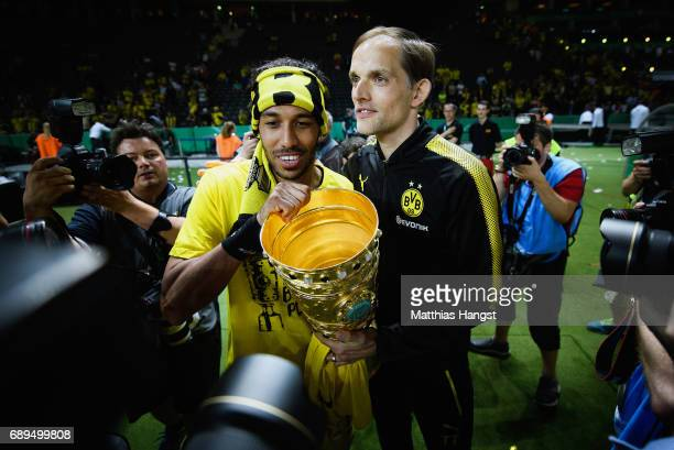 PierreEmerick Aubameyang and Thomas Tuchel of Dortmund celebrate with the trophy after winning the DFB Cup Final 2017 between Eintracht Frankfurt and...