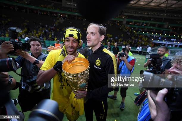 PierreEmerick Aubameyang and Thomas Tuchel of Dortmund look on with the trophy after winning the DFB Cup Final 2017 between Eintracht Frankfurt and...
