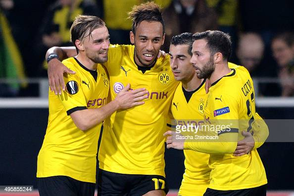 PierreEmerick Aubameyang celebrates with team mates Marcel Schmelzer Henrikh Mkhitaryan and Gonzalo Castro of Dortmund after scoring his team's...