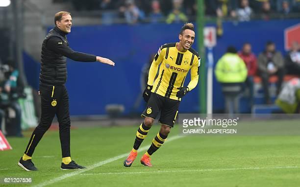 PierreEmerick Aubameyang from Dortmund celebrateS with coach Thomas Tuchel his goal during the German first division Bundesliga football match...