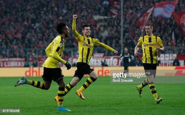 PierreEmerick Aubameyang Julian Weigl and Sven Bender of Borussia Dortmund celebrate during the DFB Cup semi final match between FC Bayern Muenchen...