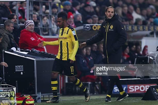 PierreEmerick Aubameyang leaves the pitch next to head coach Thomas Tuchel of Dortmund during the Bundesliga match between 1 FSV Mainz 05 and...