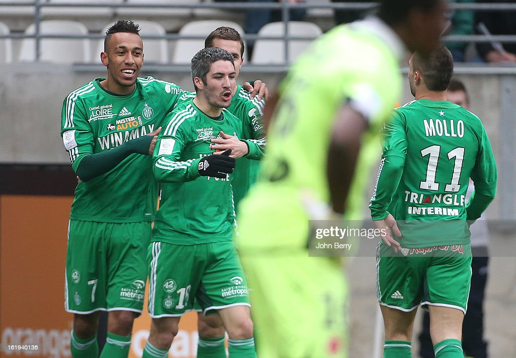 Pierre-Emerick Aubameyang of ASSE celebrates his goal with Fabien Lemoine and Yohan Mollo during the french Ligue 1 match between Stade de Reims and AS Saint-Etienne at the Stade Auguste Delaune on February 17, 2013 in Reims, France.