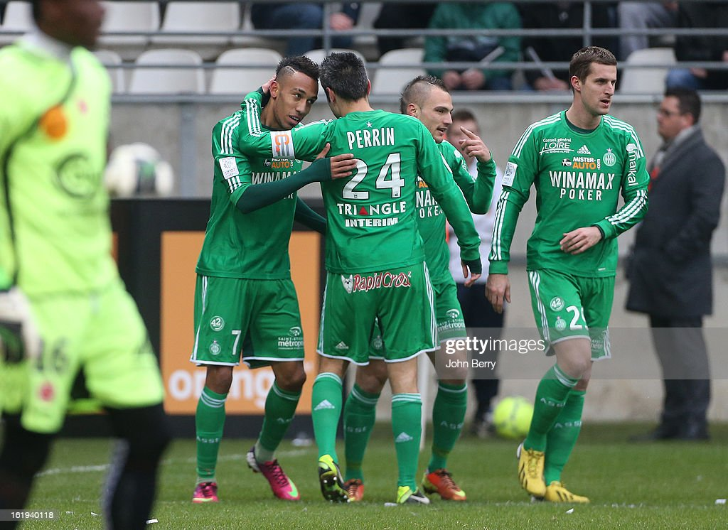 Pierre-Emerick Aubameyang of ASSE celebrates his goal with Loic Perrin and Francois Clerc during the french Ligue 1 match between Stade de Reims and AS Saint-Etienne at the Stade Auguste Delaune on February 17, 2013 in Reims, France.