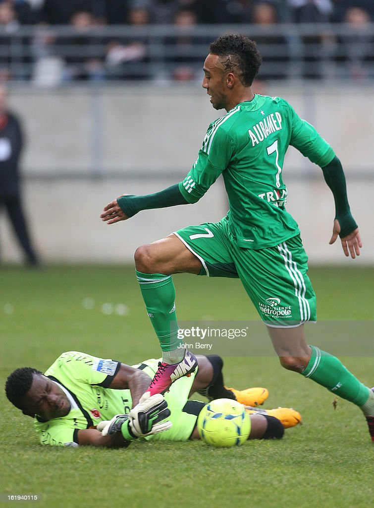 Pierre-Emerick Aubameyang of ASSE is stopped by Kossi Agassa, goalkeeper of Reims during the french Ligue 1 match between Stade de Reims and AS Saint-Etienne at the Stade Auguste Delaune on February 17, 2013 in Reims, France.