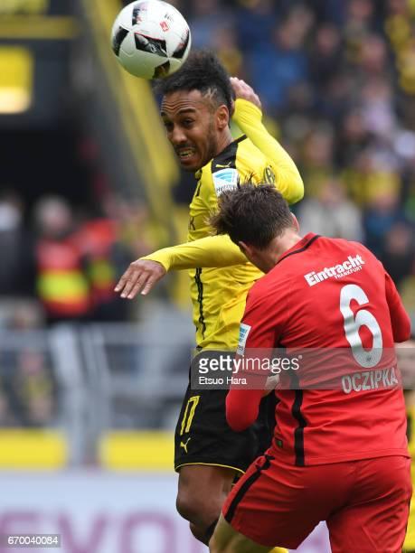 PierreEmerick Aubameyang of Borussia Dortmund and Bastian Oczipka of Eintracht Frankfurt compete for the ball during the Bundesliga match between...