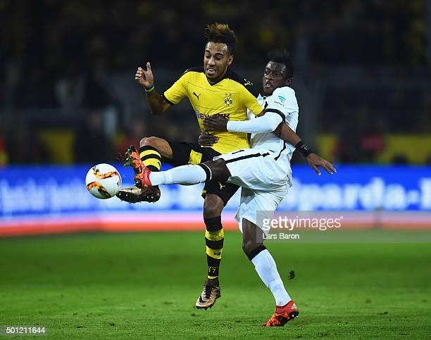 PierreEmerick Aubameyang of Borussia Dortmund and David Kinsombi of Eintracht Frankfurt battle for the ball during the Bundesliga match between...