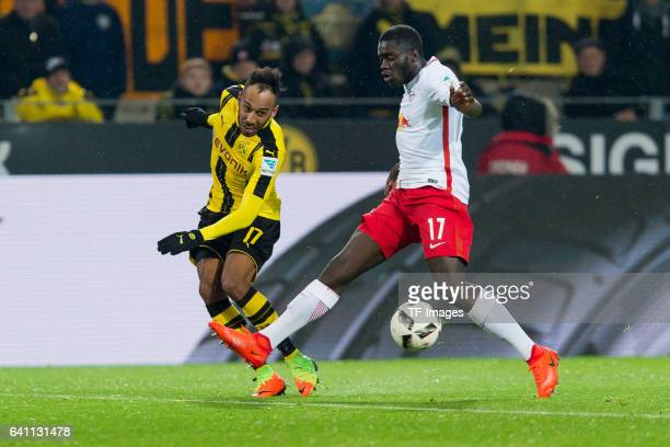 PierreEmerick Aubameyang of Borussia Dortmund and Dayot Upamecano of RB Leipzig battle for the ball during the Bundesliga soccer match between...