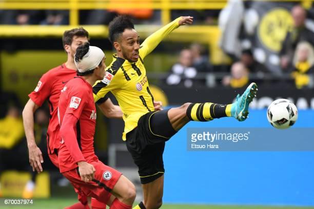 PierreEmerick Aubameyang of Borussia Dortmund and Jesus Vallejo of Eintracht Frankfurt compete for the ball during the Bundesliga match between...
